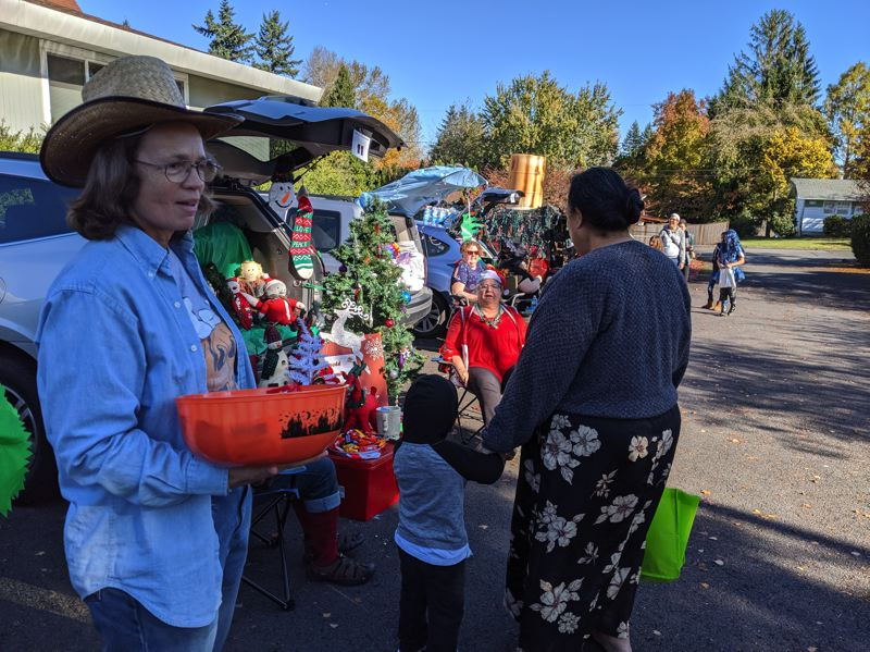 PMG PHOTO: BRITTANY ALLEN - Linda Bush passed out candy during the Gresham United Methodist Churchs Trunk or Treat.