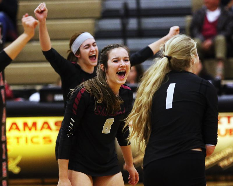 PMG PHOTO: DAN BROOD - Sherwood High School players (from left) Julia Leitzinger, Emma Wagner and Alli Douglass celebrate during the fifth set of the Lady Bowmen's playoff win at Clackamas.