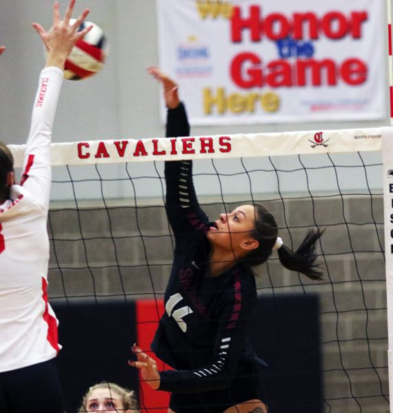 PMG PHOTO: DAN BROOD - Sherwood High School senior Natalie Kapuniai-Ryan (right) goes up for a kill during the Lady Bowmen's state playoff win at Clackamas on Oct. 30.