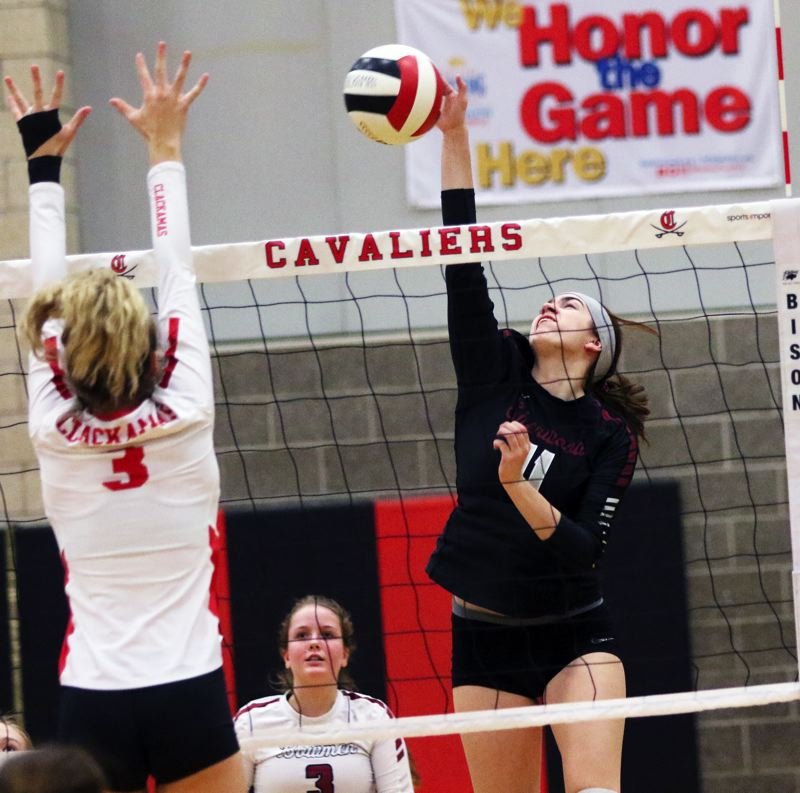 PMG PHOTO: DAN BROOD - Sherwood High School senior Julia Leitzinger (right) goes up for a kill during the Lady Bowmen's five-set state playoff win at Clackamas on Oct. 30.