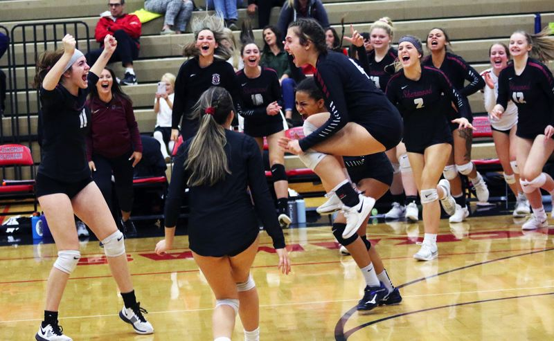 PMG PHOTO: DAN BROOD - The Sherwood High School volleyball team starts celebrating following the team's five-set state playoff win at Clackamas on Oct. 30.