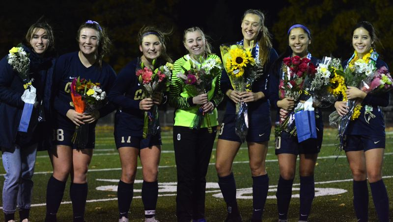 PMG PHOTO: DEREK WILEY - Canby honored its seven seniors before Tuesday's final game against West Linn.