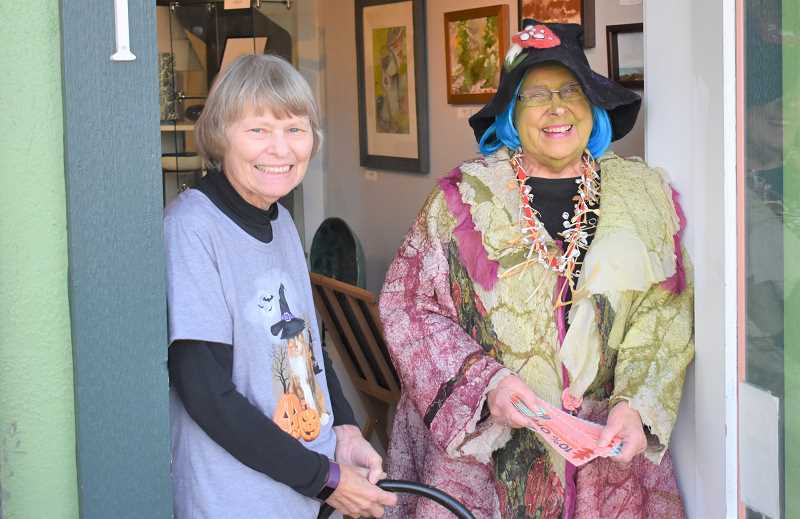 PMG PHOTO: EMILY LINDSTRAND - Louise Stivers and Annette Reisbick are all smiles at the Spiral Gallery during the Creepy Crawl.