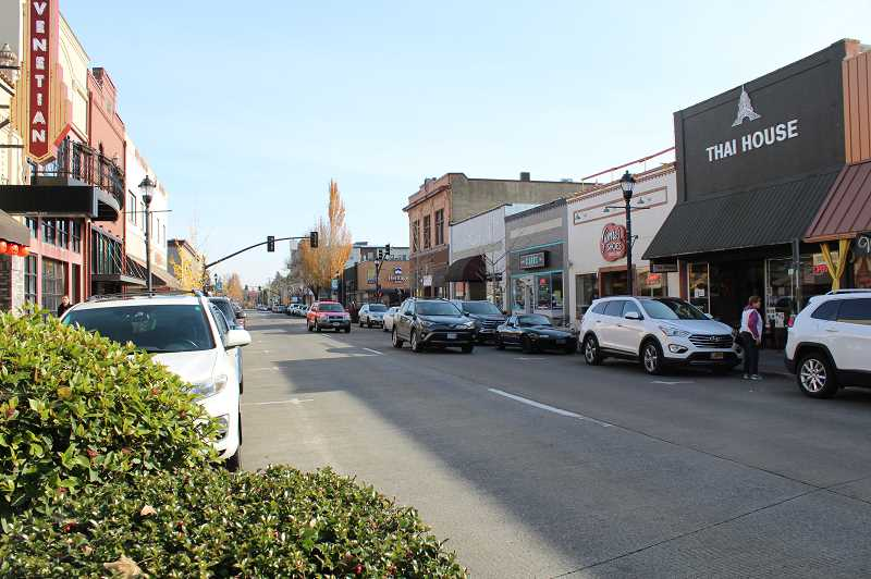 PMG PHOTO: GABBY URENDA - Cars driving west on E Main Street in downtown Hillsboro, one of the streets the Hillsboro History Society aims to preserve.