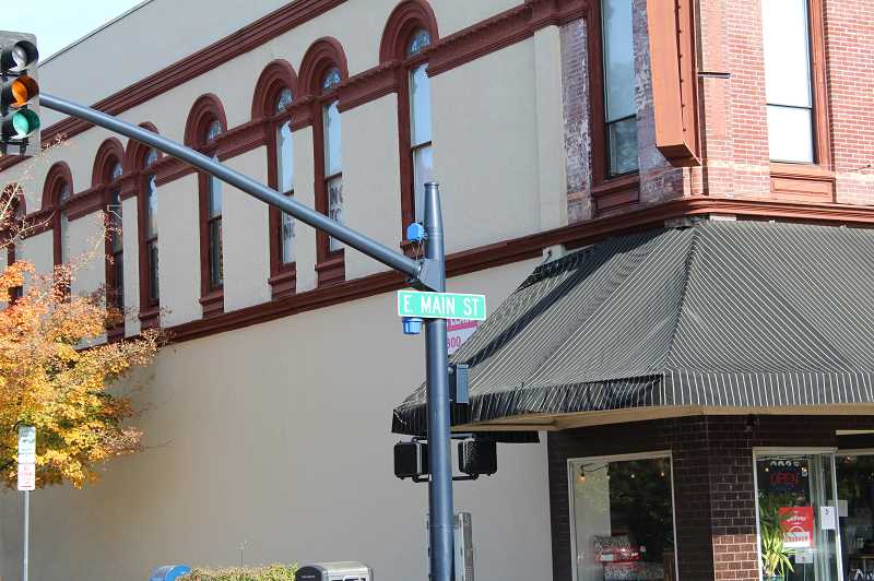 PMG PHOTO: GABBY URENDA - A street sign reading E Main Street in Downtown Hillsboro. The Hillsboro Historical Society wants to add more historical and artistic signs to the area.