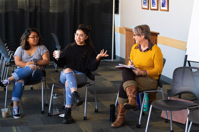 PMG PHOTO: CHRIS OERTELL - Ellen Knutson, right, an associate professor at the University of Illinois, leads a community discussion on what it means to be an American at Pacific University.