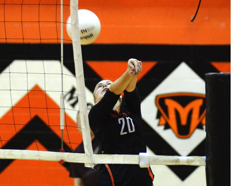 PMG PHOTO: DEREK WILEY - Molalla sophomore Sydney Thompson had 10 digs against Tillamook.
