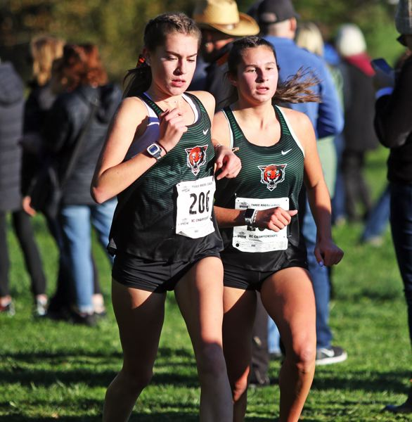 PMG PHOTO: DAN BROOD - Tigard's Isabelle Ford and Abbigale Elliott turned in strong performances for the Tigers at the Three Rivers League district cross country championships.