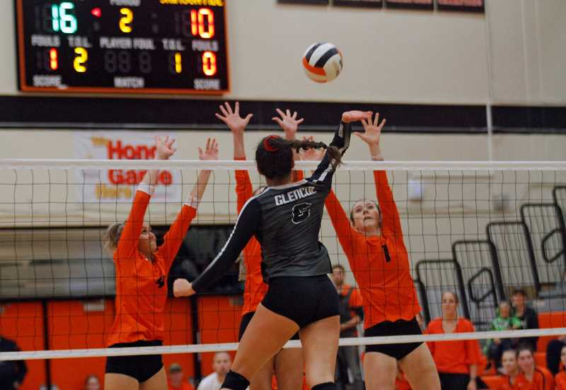 PMG PHOTO: WADE EVANSON - Glencoe's Jayda Lee rises high for a kill versus Sprague during the Crimson Tide's playoff match against the Olympians Wednesday, Oct. 30, at Sprague High School.