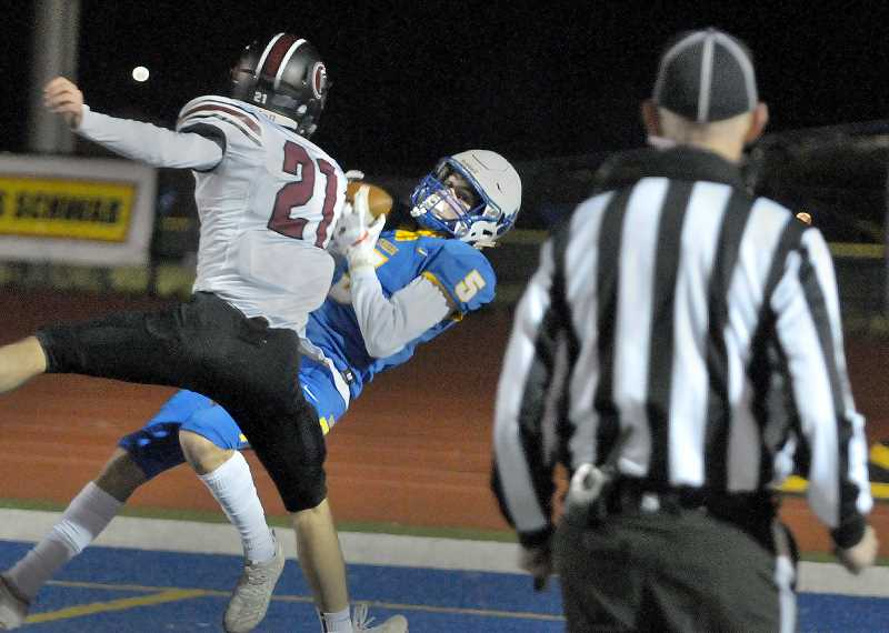 GRAPHIC PHOTO: GARY ALLEN - Junior wide receiver Owen Hawley hauls in a touchdown pass in the first quarter of Newberg's win over Glencoe Friday evening at Loran Douglas Field.