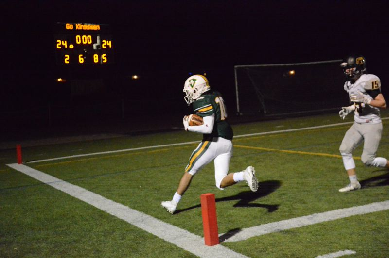 PMG PHOTO: STEVE BRANDON - Caleb Tovey of Putnam scores on an 8-yard run in overtime to give the Kingsmen a 30-24 victory over visiting St. Helens on Friday night.
