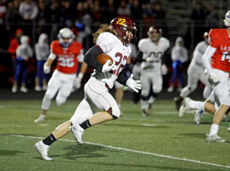 PMG PHOTO: WADE EVANSON - Forest Grove's Isaiah Ahmad carries the ball during the Vikings' game against the Falcons Friday, Nov. 1, at La Salle High School in Milwaukie.
