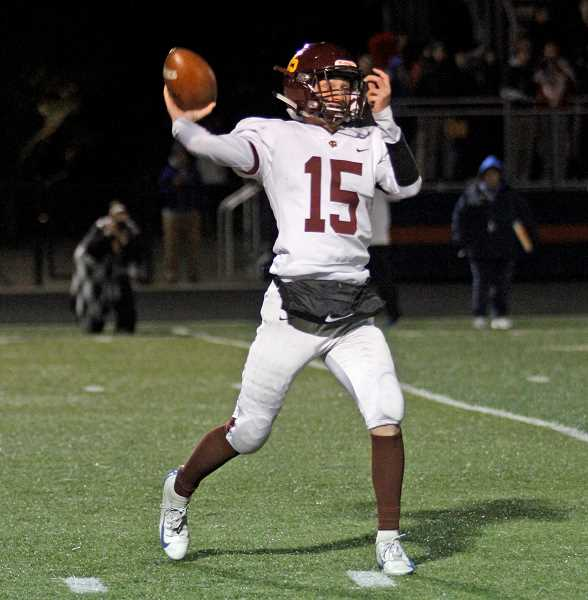 PMG PHOTO: WADE EVANSON - Forest Grove's Jarod Miller hurls a pass during the Vikings' game against the Falcons Friday, Nov. 1, at La Salle High School in Milwaukie.