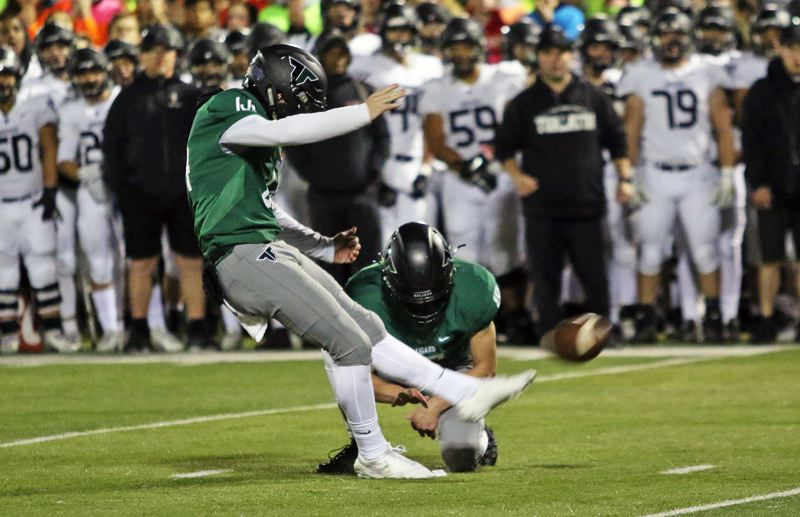 PMG PHOTO: DAN BROOD - Tigard High School senior Jackson Cleaver booted a 32-yard field goal to give the Tigers a 16-14 third-quarter lead over Tualatin.