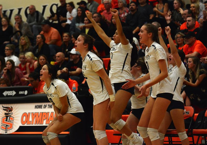 PMG PHOTO: DEREK WILEY - Canby's bench celebrates during the fifth set at Sprague High School.