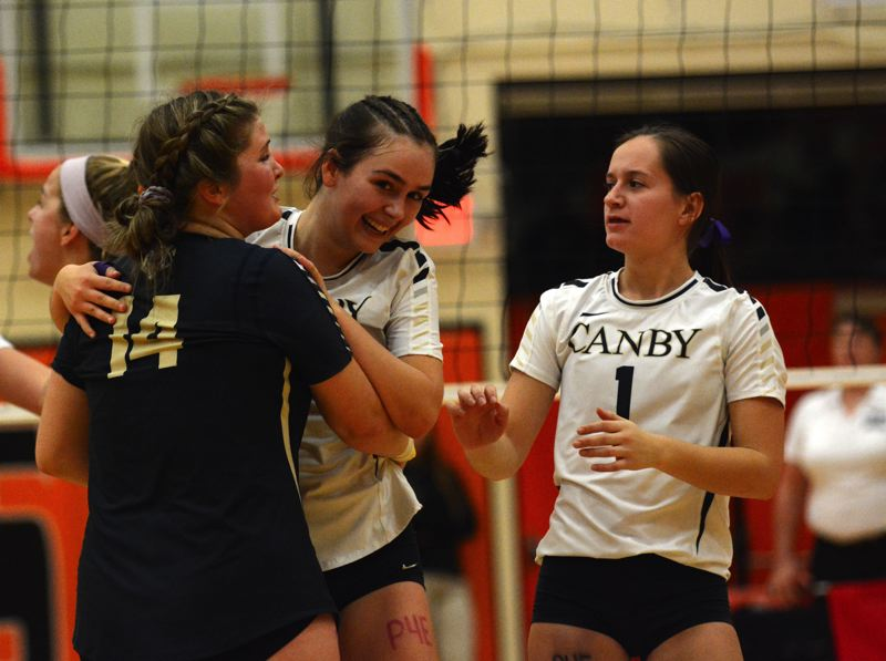 PMG PHOTO: DEREK WILEY - Canby libero Arika Evans celebrates with Caitlin Gay after Gay's ace in the fifth set.