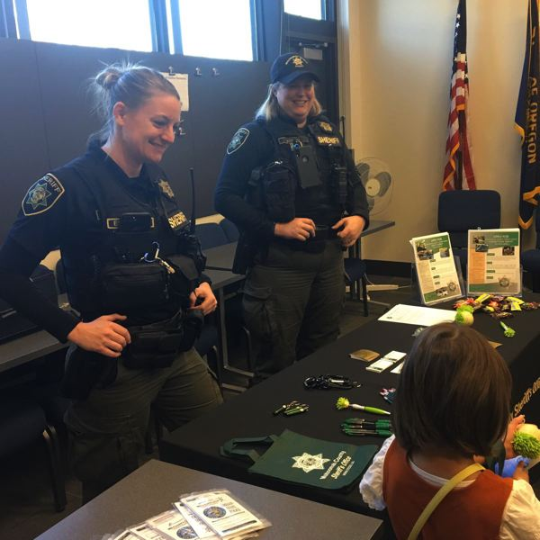 COURTESY MCSO - Women in law enforcement talked to children at the Saturday event.