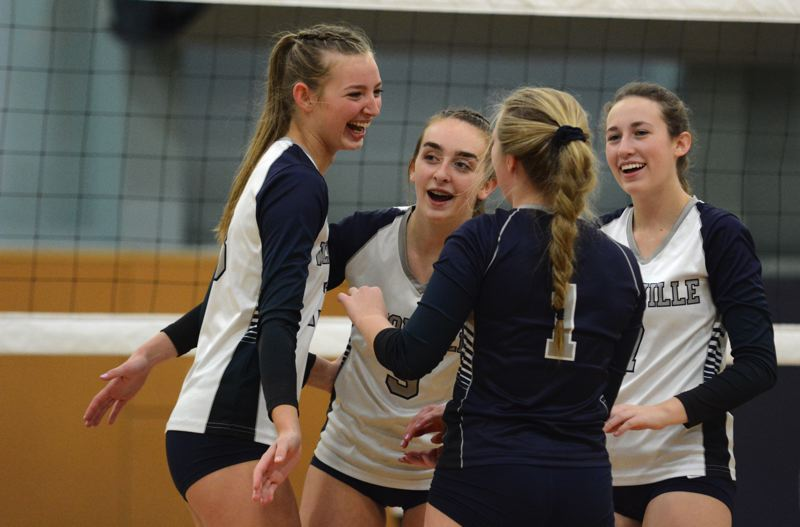 PMG PHOTO: DEREK WILEY - Lindsey Hartford, Ashli Edmiston, Kennedy Juranek and Gracie Thompson celebrate during the third set of Wilsonville's 3-0 win over Crescent Valley Saturday.