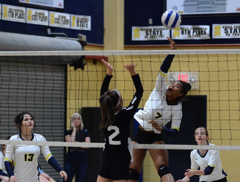 PMG PHOTO: DEREK WILEY - Country Christian sophomore McKenzie Syphard had 16 kills Saturday against Central Christian.