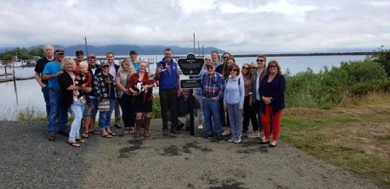 COURTESY PHOTO: OREGON FILM - Organizers gathered for the installation of a 'Free Willy' sign at Hammond Marina in Warrenton. It has become a really big deal for people to rally around the memories of a film and install a sign, said Tim Williams of Oregon Film..