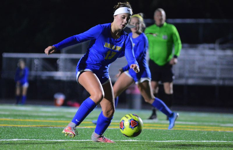 PMG PHOTO: DAVID BALL - Barlows Abbie Nelson settles a ball in front of the Oregon City goal during the first half of Saturdays 2-1 playoff win.