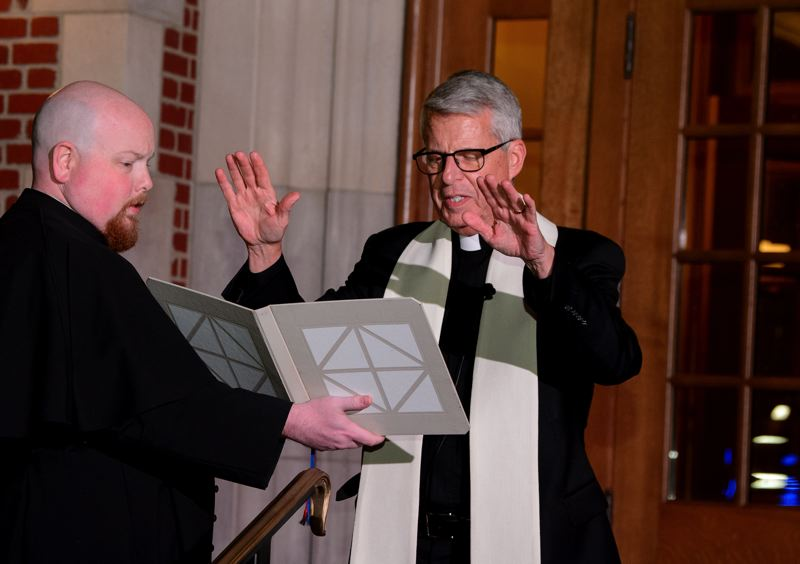 COURTESY: UNIVERSITY OF PORTLAND - Rev. Mark L. Poorman, president of the University of Portland, blesses Dundon-Berchtold Hall during dedication events on Sept. 26. Assisting him is Rev. Timothy Weed, program director for campus ministry.