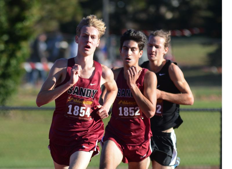 PMG PHOTO: DAVID BALL - Sandys Jeret Gillingham and Tyler Callaway round the corner on the way to the finish line in Wednesdays district cross country meet.