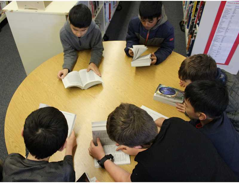 PMG PHOTO: ASIA ALVAREZ ZELLER - A group of students peruse their newly gifted dictionaries.