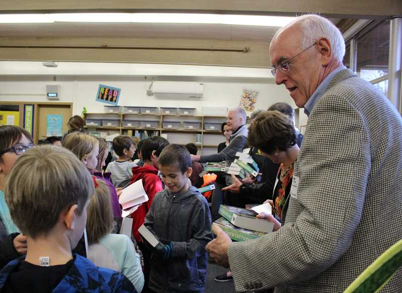 PMG PHOTO: ASIA ALVAREZ ZELLER - Rotarians hand out dictionaries to students.