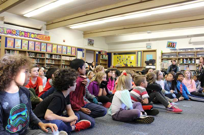 PMG PHOTO: ASIA ALVAREZ ZELLER - Third graders sit in the library and listen to rotary members give speech.