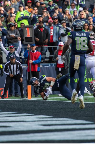 MICHAEL WORKMAN PHOTO - Jacob Hollister hauls in a touchdown for the Seattle Seahawks as they defeat the Tampa Bay Buccaneers on Sunday at CenturyLink Field.