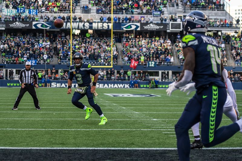 MICHAEL WORKMAN PHOTO - Russell Wilson of Seattle fires a pass to receiver DK Metcalf.