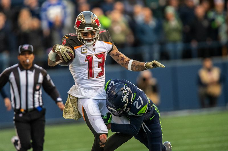 MICHAEL WORKMAN PHOTO - Free safety Marquise Blair of Seattle brings down Tampa Bay receiver Mike Evans.