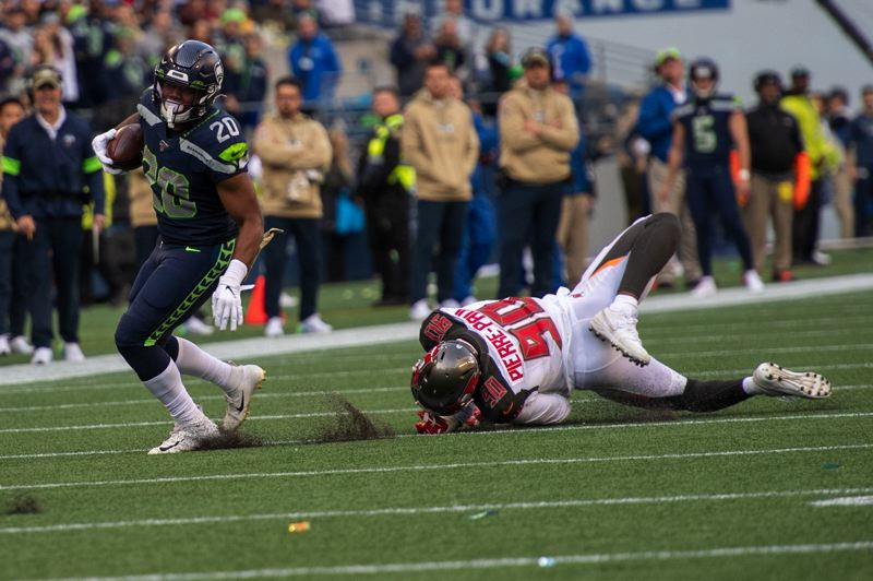 MICHAEL WORKMAN PHOTO - Rashaad Penny of Seattle gets past a Buccaneers defender.