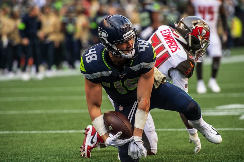 MICHAEL WORKMAN PHOTO - Seattle's Jacob Hollister, a tight end out of Mountain View High in Bend, makes a key catch in the Seahawks' victory over Tampa Bay.