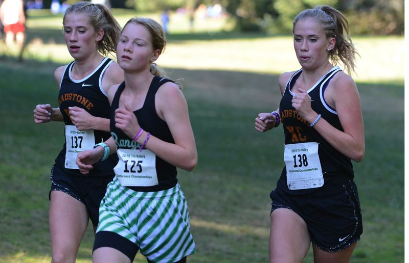 PMG PHOTO: DAVID BALL - Estacada rookie Heather Shaver staved off Gladstone twins Brynn and Brooklyn Tatom through the entire 3.1-mile course, pulling away late to win in 21:26.68.