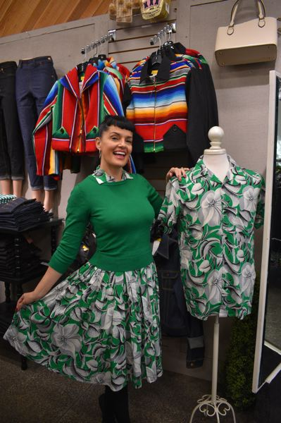 PMG PHOTO: SHANNON O. WELLS - Bernie Dexter has sold fashionably retro and bold-patterned dresses and clothing on Main Avenue since September 2015. She is hosting a grand re-opening celebration at her new space on Nov. 14.