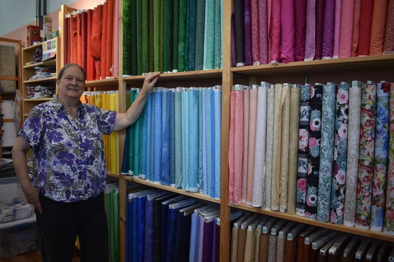 PMG PHOTO: SHANNON O. WELLS - Kris Howatt is pleased to have more room to house quilting material as well as teach classes and workshops at her larger location in downtown Gresham.