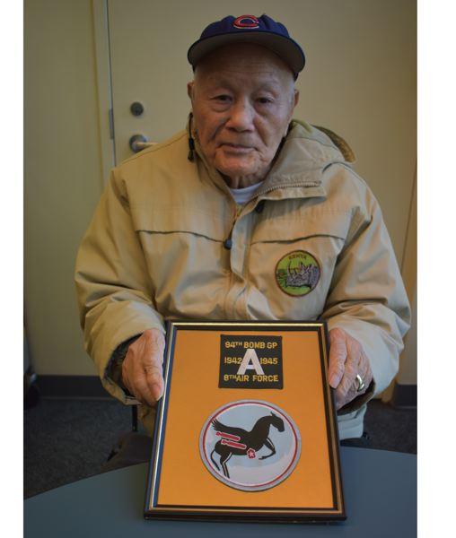 PMG PHOTO: RAYMOND RENDLEMAN - Milwaukie resident James Hong shows the patches identifying his branch of service during World War II.