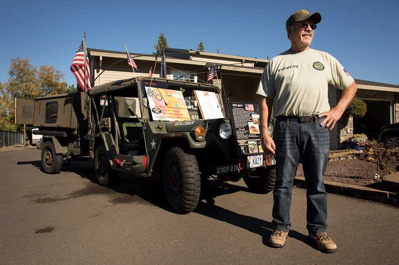PMG PHOTO: JAIME VALDEZ - Dennis Weehunt, a resident of Aurora, stands by his 1972 M151 Ford 4x4 Vietnam military vehicle and trailer that he refurbished.