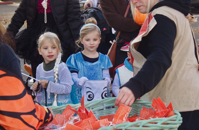 PMG PHOTO: CHRISTOPHER KEIZUR - Children enjoyed searching for candy during downtown Greshams annual Safe Trick-or-Treat event on Halloween night, Oct. 31.