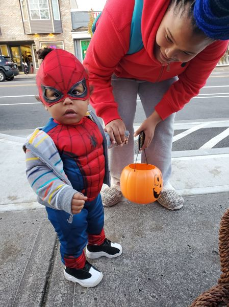 COURTESY PHOTO: DIANE CASTILLO-WHITE  - A tiny Spider-Man came to downtown Troutdale with the express purpose of snaring candy in his web.