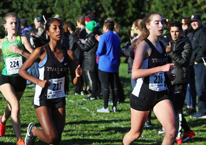 PMG PHOTO: DAN BROOD - Tualatin High School sophomore Mahathi Sridhar (left) and junior Olivia Seits helped the Timberwolf girls finish second in the team standings at the Three Rivers League district cross country meet.