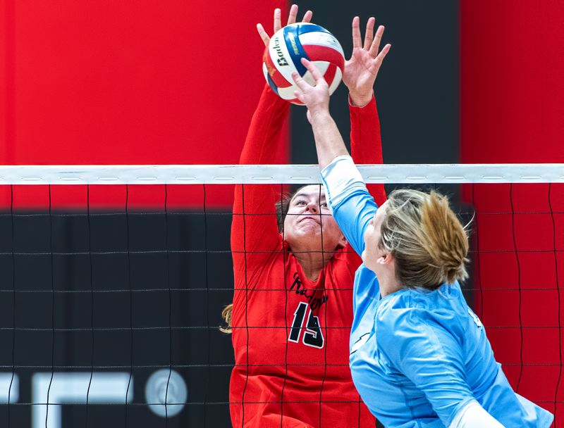 ASHLAND DAILY PHOTO: AL CASE - Barlow High graduate Maddie Pernich goes up for a block for Southern Oregon.
