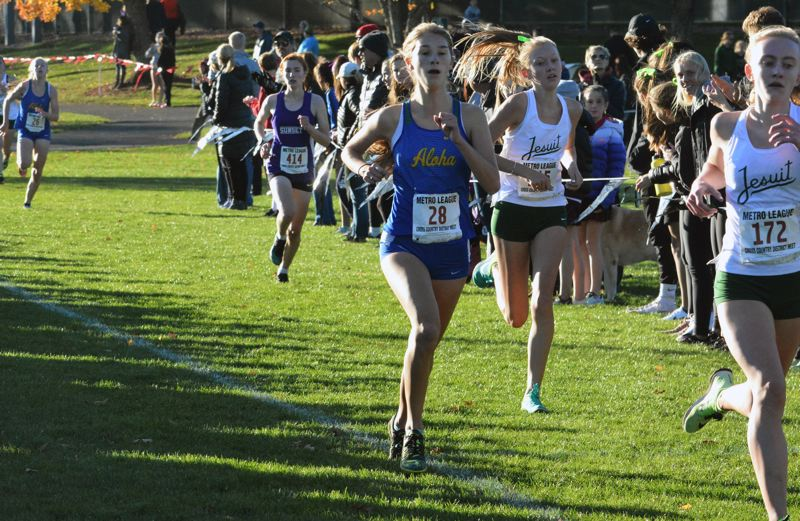 TIMES PHOTO: MATT SINGLEDECKER - Aloha senior Emily Foote will finish her cross country career with her teammates at the Class 6A state meet.