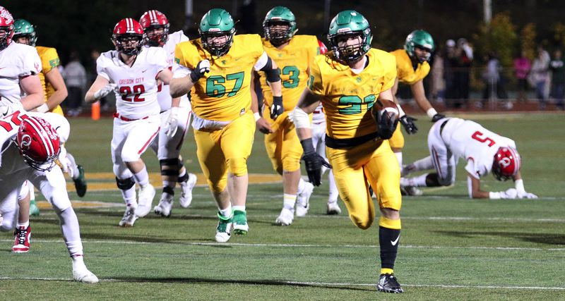 PMG PHOTO: BRIAN MONIHAN - West Linn junior running back Gavin Haines breaks a 47-yard TD run during his team's 52-7 win over Oregon City on Friday, Nov. 1, at West Linn High School.