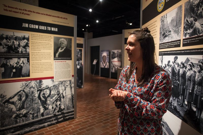 "PMG PHOTO: JAIME VALDEZ - Rachel Randles, director of marketing and communications for the Oregon Historical Society, provides a glimpse of the museum's featured exhibit, ""Fighting for the Right to Fight: