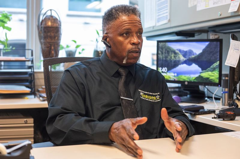 PMG PHOTO: JONATHAN HOUSE - Napoleon Hodgers, Outreach Director of the Portland chapter of the National Association for Black Veterans, at his desk in his downtown office.