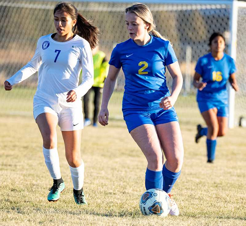 LON AUSTIN/CENTRAL OREGONIAN - Teagan Freeman plays a ball during the Cowgirls match with Ridgeview on Tuesday. Crook County cloesd out their regular season on Thursday with a road loss to the Redmond Panthers. The 8-0 loss left the Cowgirls winless on the year.