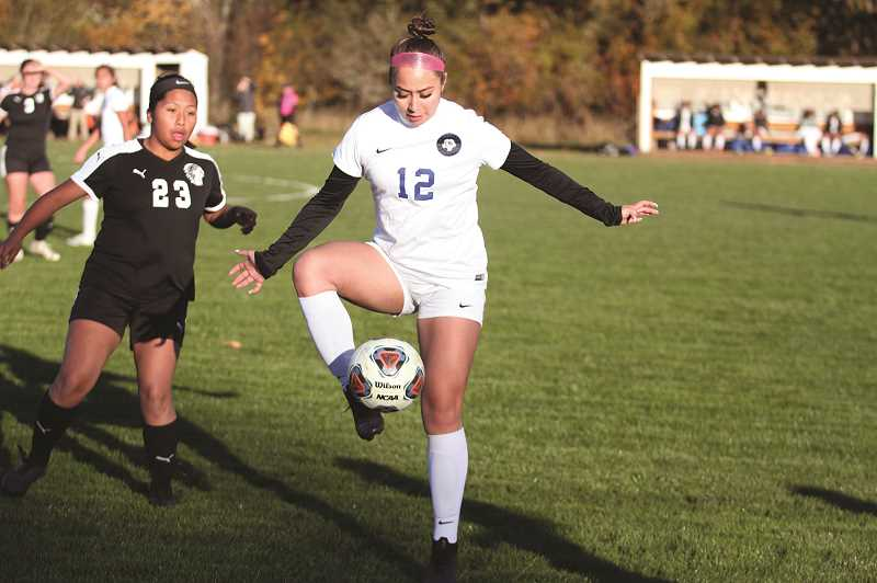PMG PHOTO: PHIL HAWKINS - Junior defender Jessica Baron and the Bulldogs will face the Valley Catholic Valiants in the first round of the state playoffs, a rematch of last year's 3-1 playoff loss.
